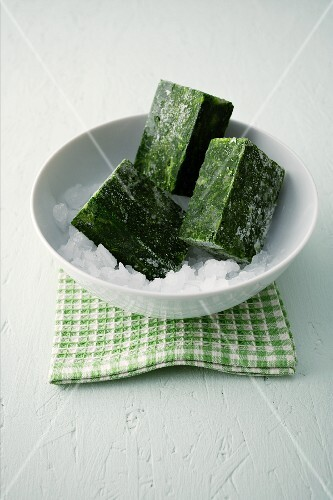 Frozen spinach in a bowl of ice