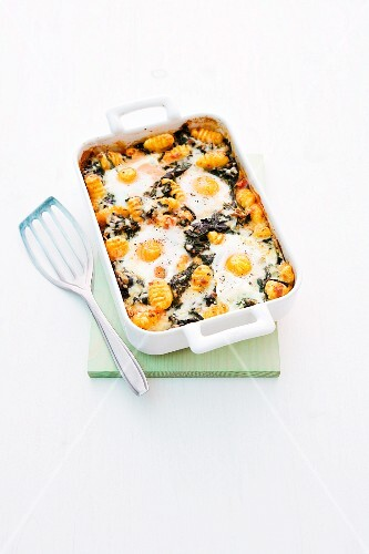 Gnocchi bake with spinach and fried egg