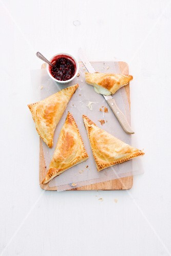 Puff pastry triangles filled with Camembert and chicory served with cranberry jam