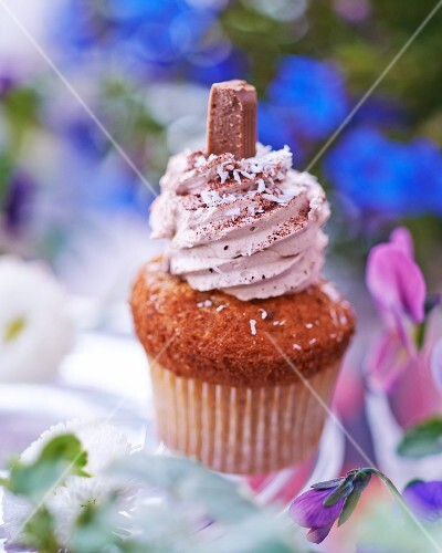 A cupcake topped with chocolate cream