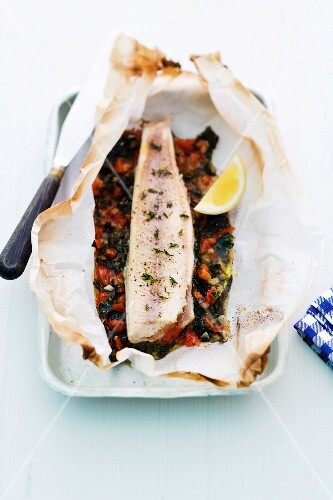 Char fillet with tomatoes in parchment paper