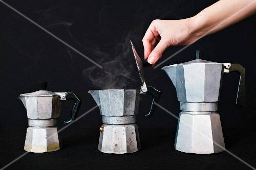 Steaming coffee in a vintage espresso maker