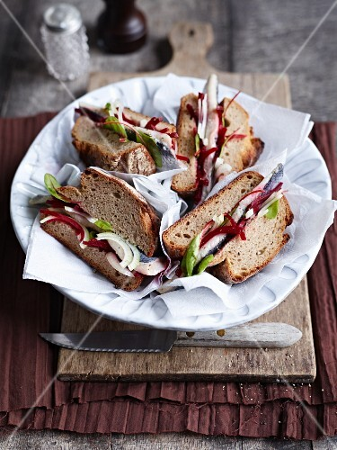 Bismarck herring, onion and beetroot sandwiches