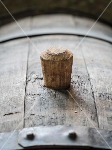 An oak barrel with a wooden bung (cork) in a wine cellars in the Kakheti wine region, Georgia, Caucasus