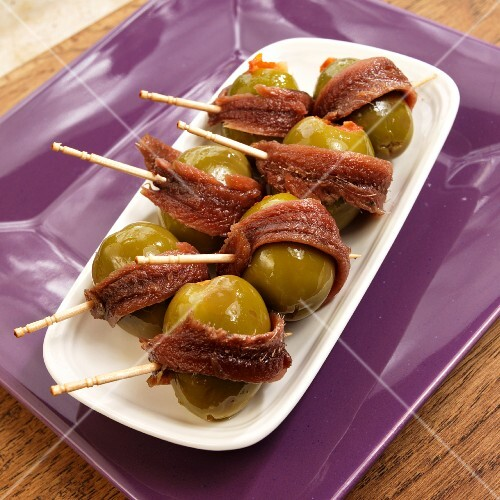 Green olives wrapped in anchovies (Spanish tapas)