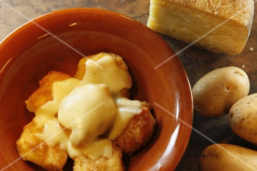 Fried potatoes with cheese (speciality from Piedmont, Italy)