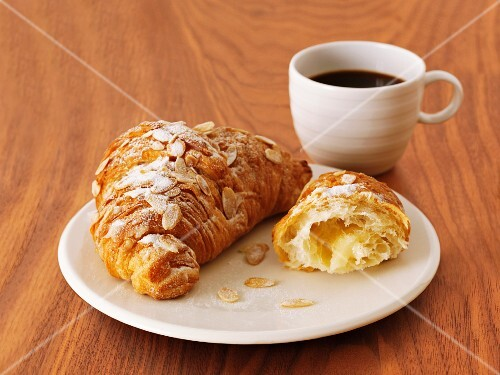 Croissants with slivered almonds and coffee