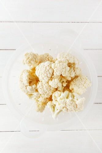 Fresh cauliflower in a colander