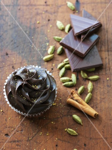 A chocolate cupcake with cardamom and cinnamon