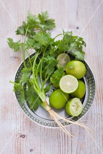 An arrangement of limes and fresh coriander
