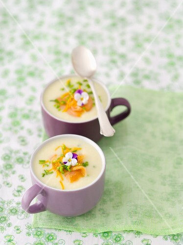 Cream of white asparagus soup with smoked salmon and orange zest