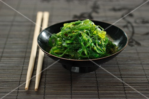A bowl of seaweed salad with chopsticks (Japan)