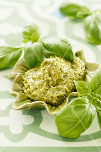 Basil pesto and fresh basil leaves