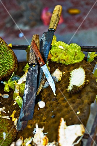 Knives and remains of a chopped durain at a market in Haiphong, Vietnam