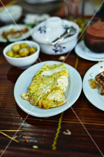 Vietnamese omelette on a laid table