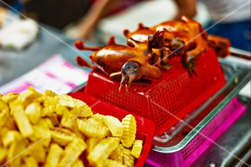 Roasted pigeon and chips at a market in Haiphong, Vietnam