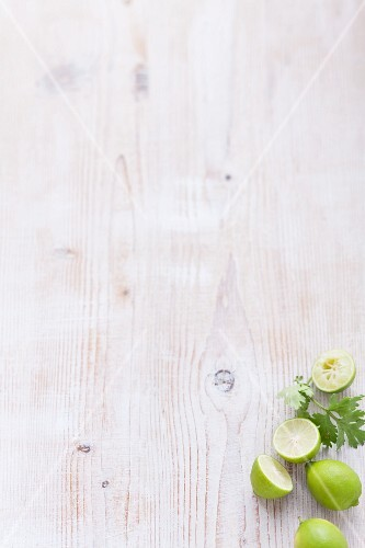 Limes on a white wooden table