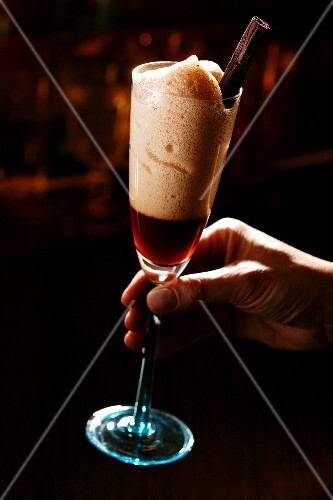 A hand holding a spiced cocktail