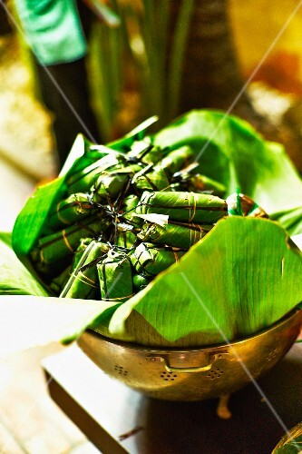 Steamed banana leaf parcels at a market in Saigon (Vietnam)