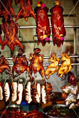 Poultry and suckling pigs in a butcher's shop in Saigon (Vietnam)