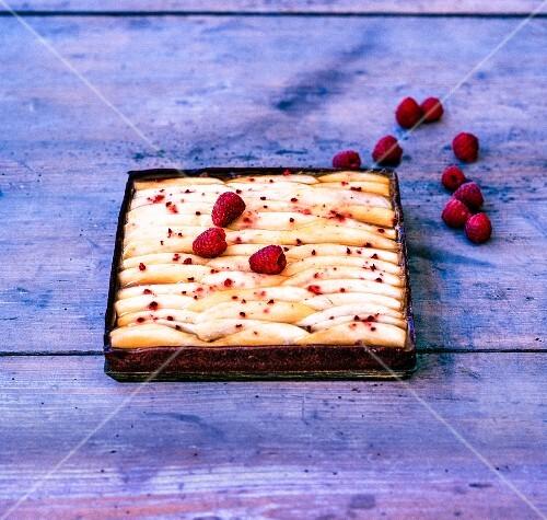 Salted caramel tart with mango and raspberries
