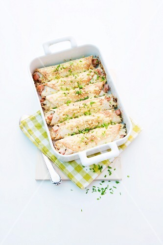 Tortilla bake with Leberkäse (beef and pork meatloaf), sauerkraut and chives