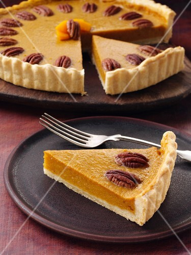 Butternut squash pie with pecan nuts, sliced