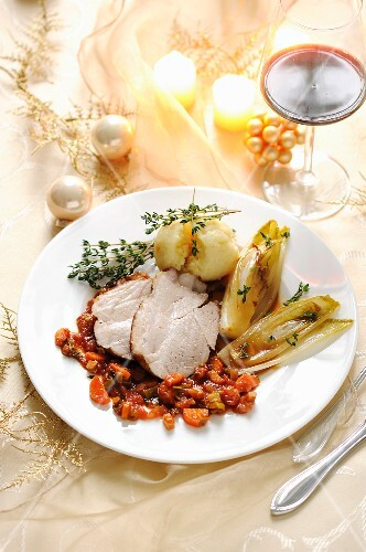 Roast pork with chicory and potato dumplings for Christmas