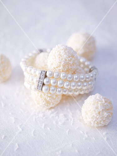 White coconut truffles with a pearl bracelet