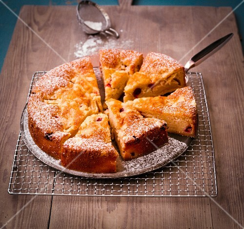 Polish apple and gooseberry cake dusted with icing sugar