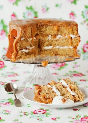 Apple and cinnamon sponge cake with a caramel glaze, sliced
