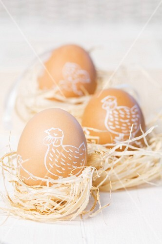 Painted Easter egg in straw nests