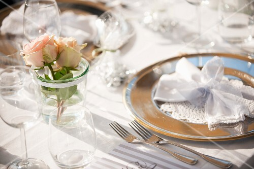 The laying of a table for a special occasion.