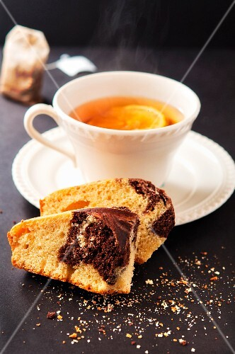Marble cake and a cup of tea with lemon