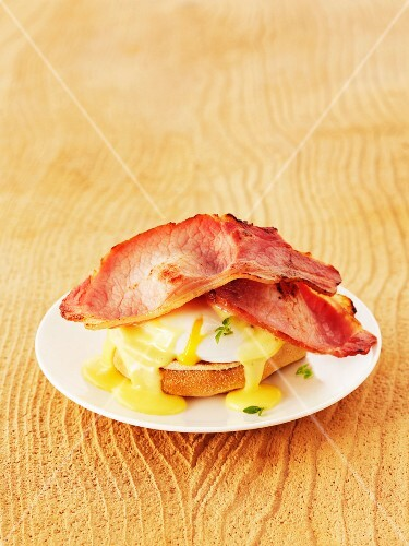 Eggs Benedict (toast topped with a poached egg, bacon and Hollandaise sauce)