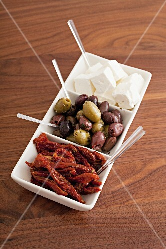 Dried tomatoes, olives and sheep's cheese as antipasti
