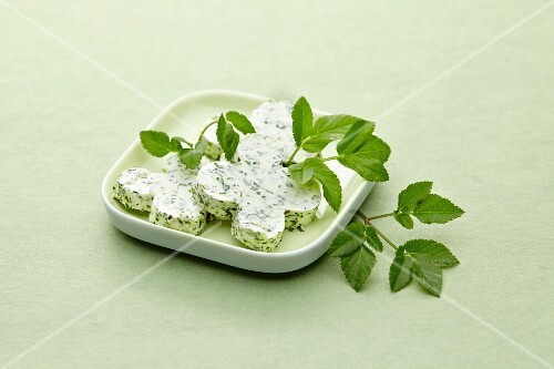 Slices of herb butter on a plate