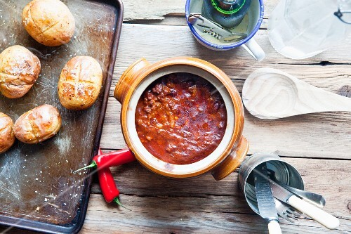 Chilli con carne and baked potatoes
