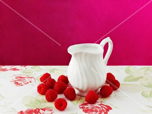 Raspberries and a jug of cream