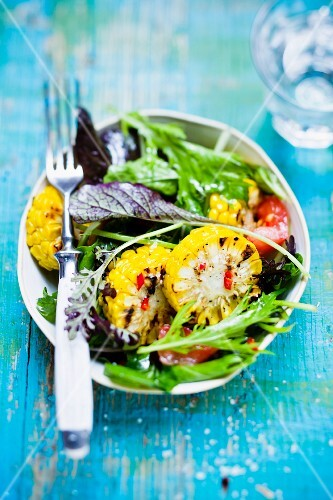 Wild herb salad with grilled corn on the cob