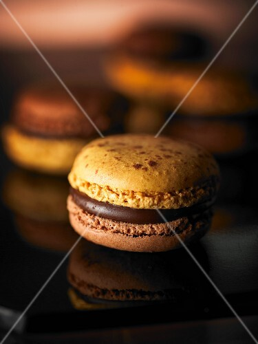 A bicoloured macaroon with chocolate cream