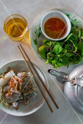 Steamed rice flour rolls, fresh herbs and tea for breakfast (Vientiane, Laos)