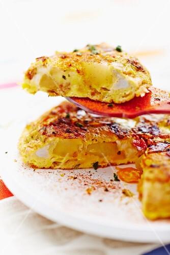 A potato tortilla, sliced