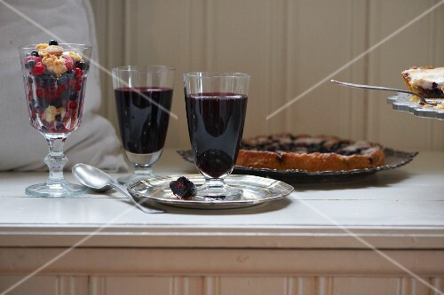 Blueberry jelly with gin, blueberry cake and a forest berry salad