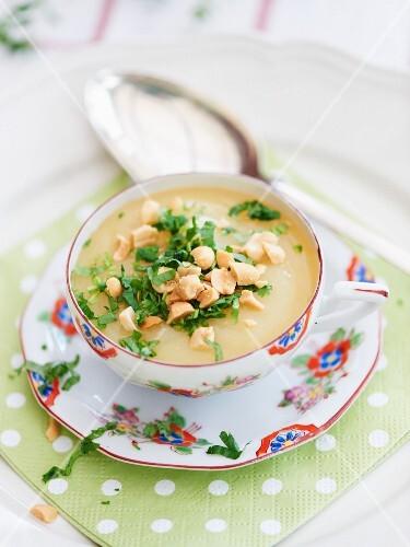 Potato and coriander soup with peanuts