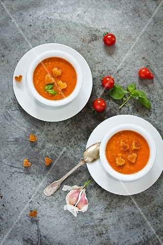 Two bowls of tomato soup with heart-shaped croutons