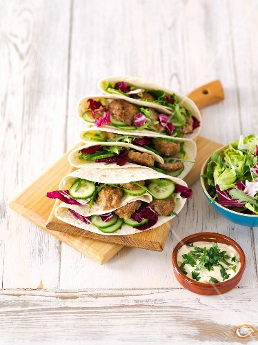 Tortillas filled with meatballs and salad