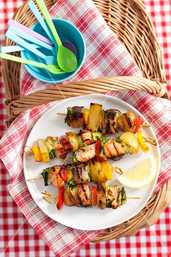 Grilled salmon and vegetable skewers for a picnic