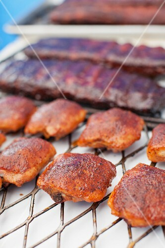 Poultry and meat for a barbecue on a grill rack
