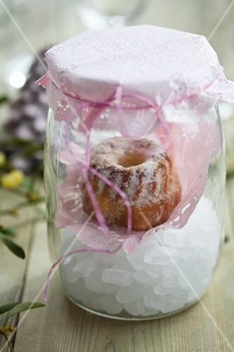 A mini Bundt cake in a preserving jar
